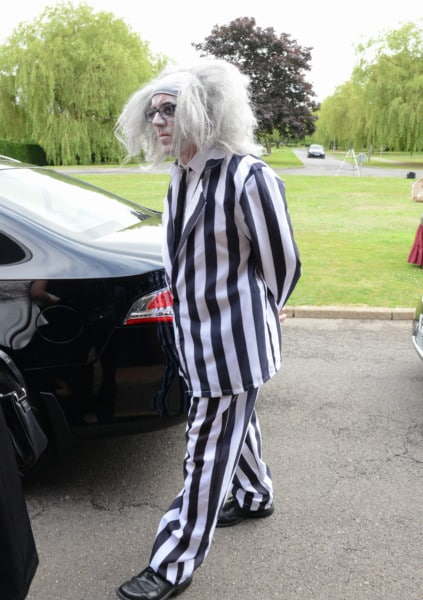 Beetlejuice arrives at the funeral